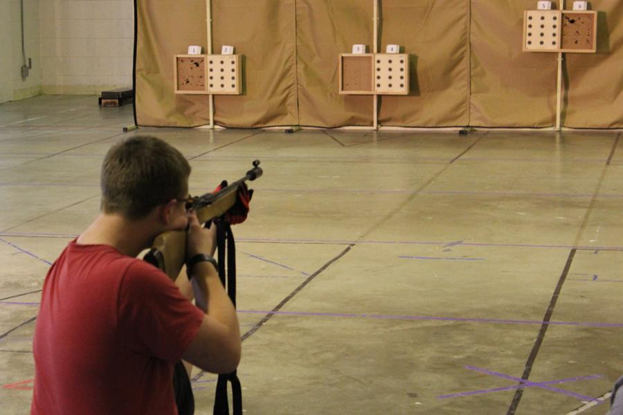 Varsity shooter Samuel Thrower aims at the target during one of their practices.
