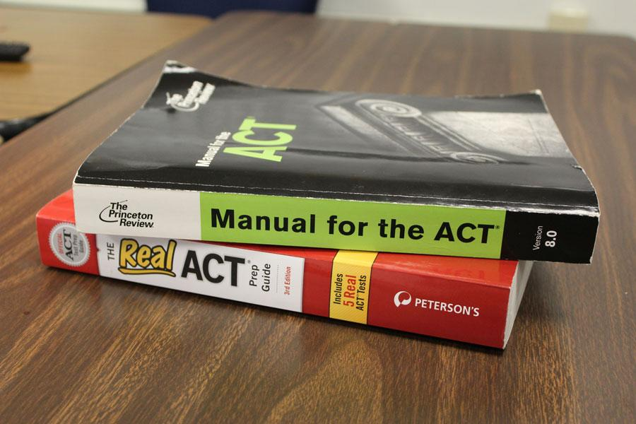 A stack of ACT prep books sits on a table, waiting to be studied.