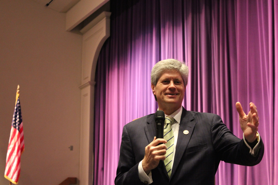 Nebraska Representative Jeff Fortenberry reaches out to the crowd of students gathered in the Bellevue West auditorium.