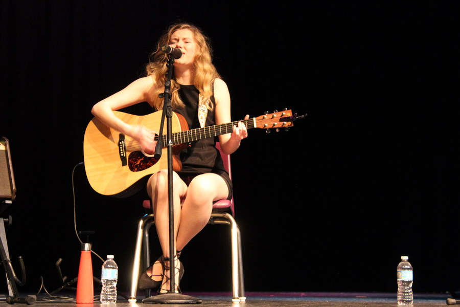 Senior Audrey Edris performs an original solo at the Songwriters Club's spring showcase.