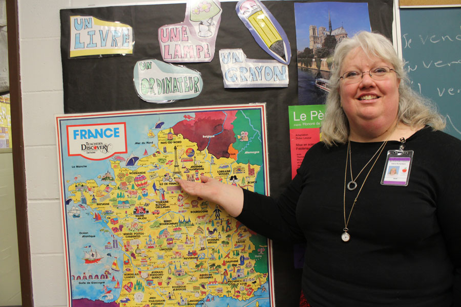 French+teacher+Debra+Richardson+points+to+a+map+of+France%2C+where+she+intends+to+travel+to+this+summer.