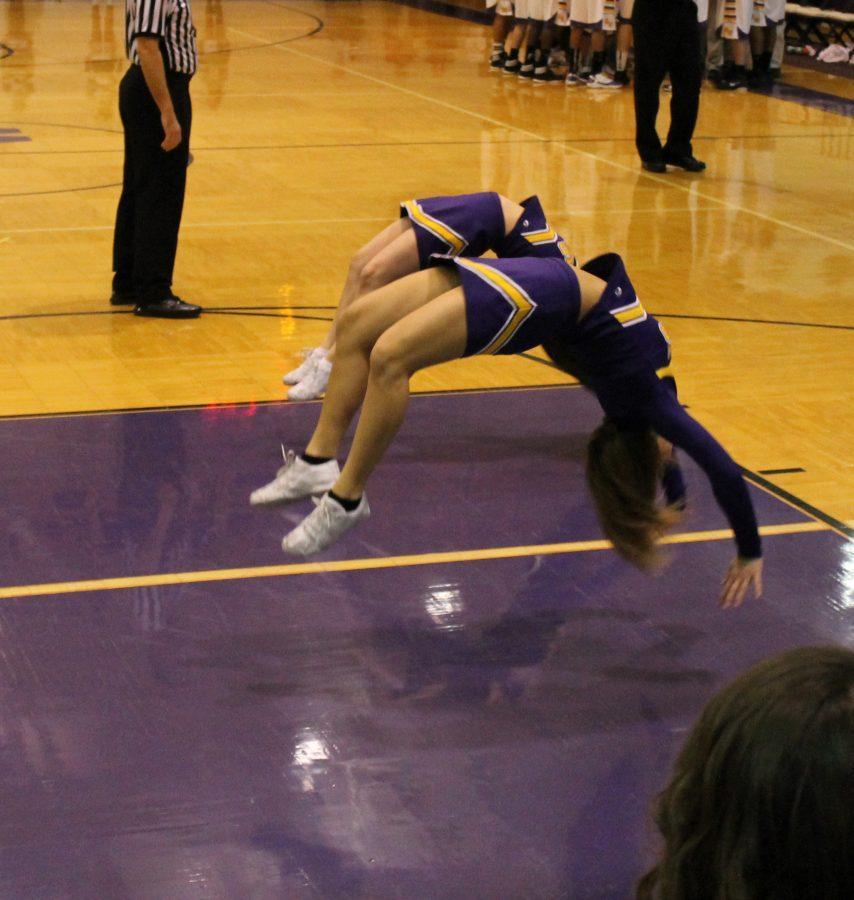 Sophomore Megan Manning and freshman Jordan Anstine show their spirit at a basketball game.