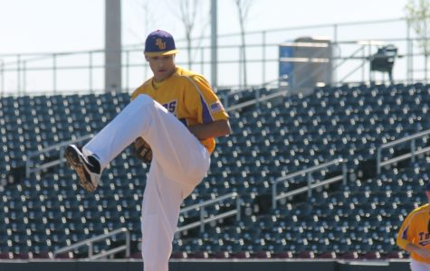 Senior Chris Luehring pitches against at the varsity game against Ralston at Werner Park. Photo by Keegan Strawmier.