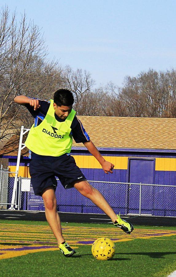 Senior Cesar Sanchez runs soccer drills at tryouts. Photo by Nic Vanderzyl.