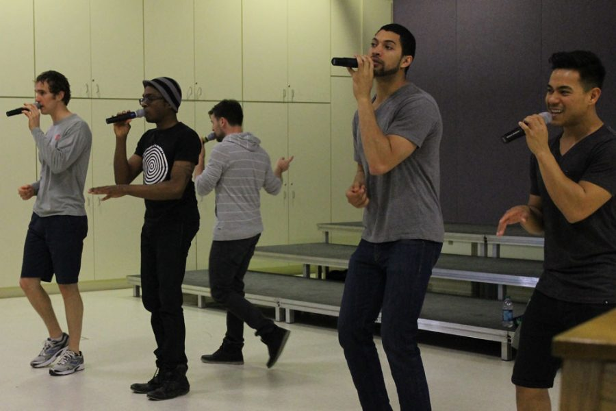West+alumnus+John+Patrick+performs+with+a+capella+group+%22Re-Voiced%22