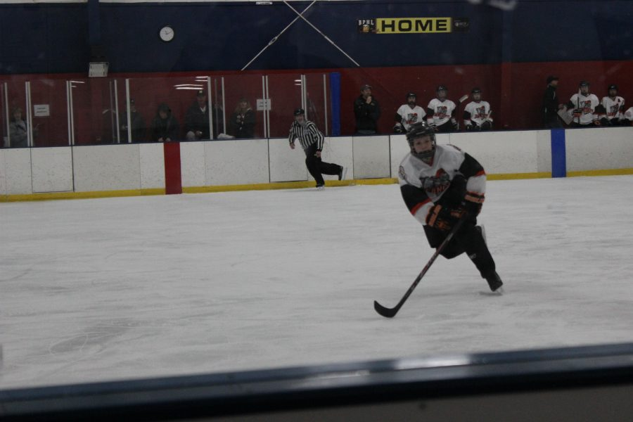 Deanna+Dymond+skates+across+the+ice+rink+during+hockey+practice.+Photo+by+Brooke+Riley