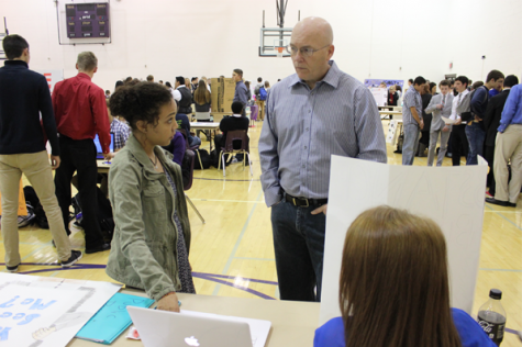 Junior Xavia Martin explains her CBL project to a visitor. Photo by Rae Rangel