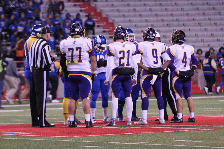 Captains+from+Bellevue+West+and+Omaha+North+meet+on+field+at+Memorial+Stadium+in+Lincoln+prior+to+kickoff.