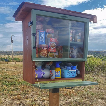 A pantry sits in Colorado where community members can take food when needed. Bellevue citizens are starting similar pantries to abolish food insecurities.