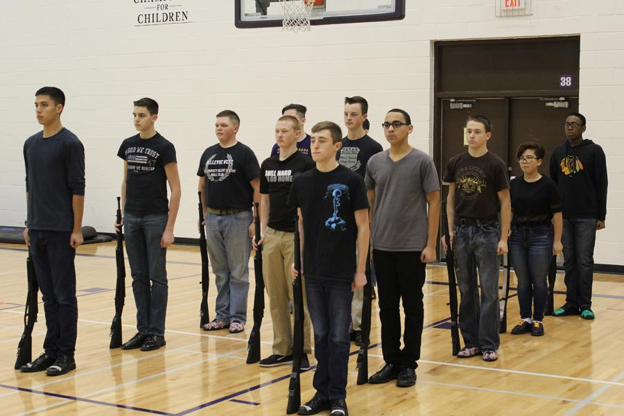 Drill team practices marching in unison for upcoming competitions.