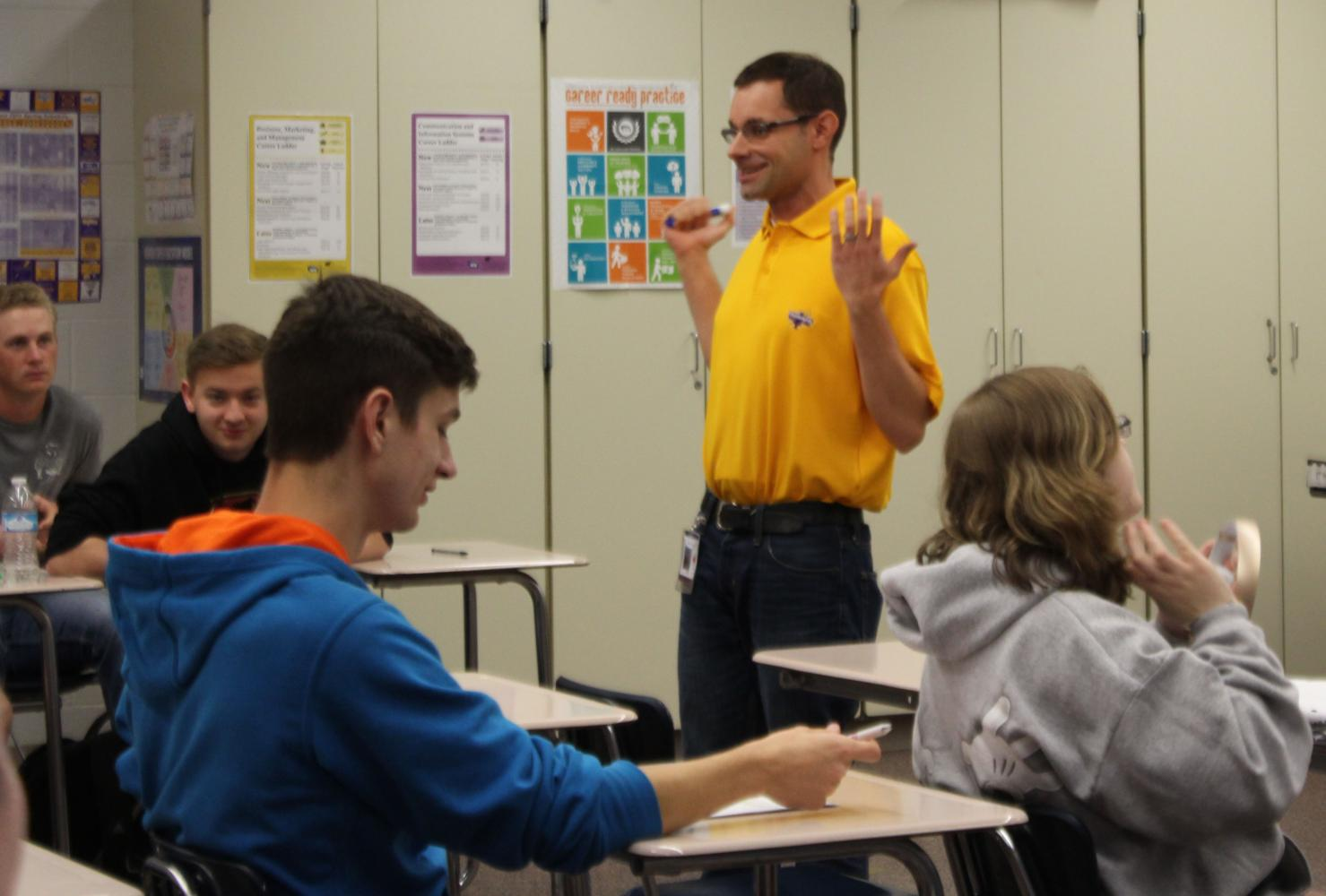 Chad Huseth teaches his career development students during class fourth hour.