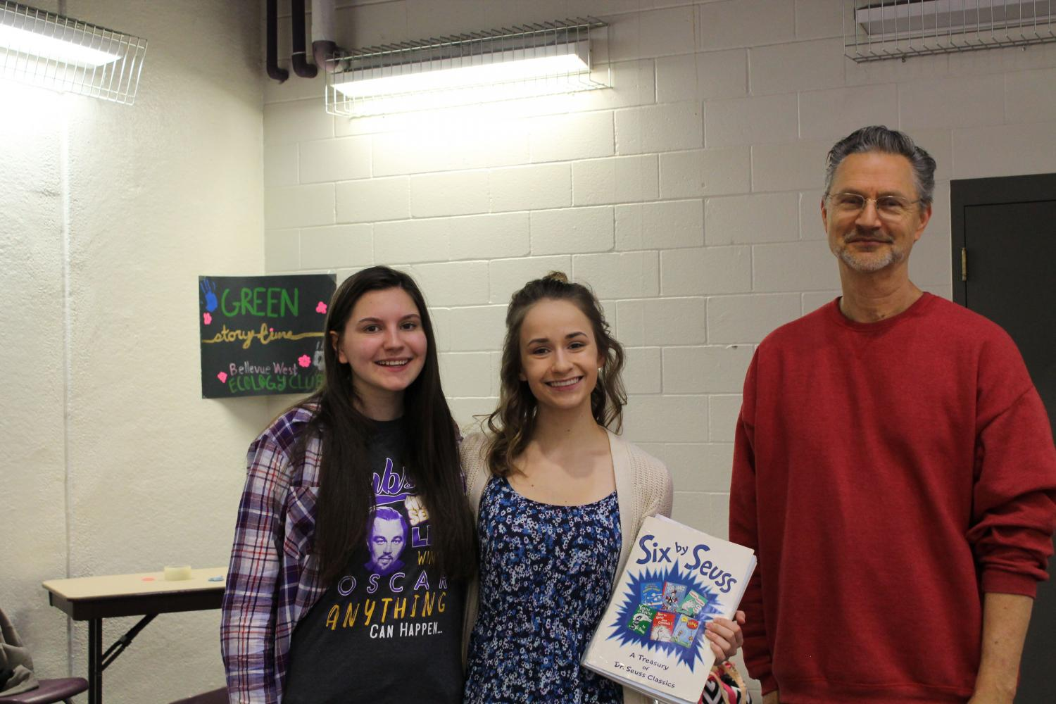 Ecology+Club+members+juniors+Kat+Woerner+and+Alexandra+Janca+and+the+club+sponsor+Steve+Thyberg+prepare+to+read+to+children+at+the+Sarpy+County+Earth+Day+on+April+30.