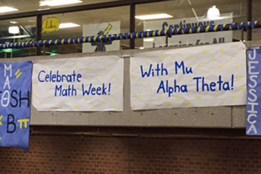 Mu+Alpha+Theta+sign+announces+Math+Week+celebration.+