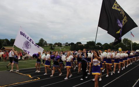 Cheerleaders and dance team members from both Bellevue West and Bellevue East walk together during the 2016 Unity Rally.