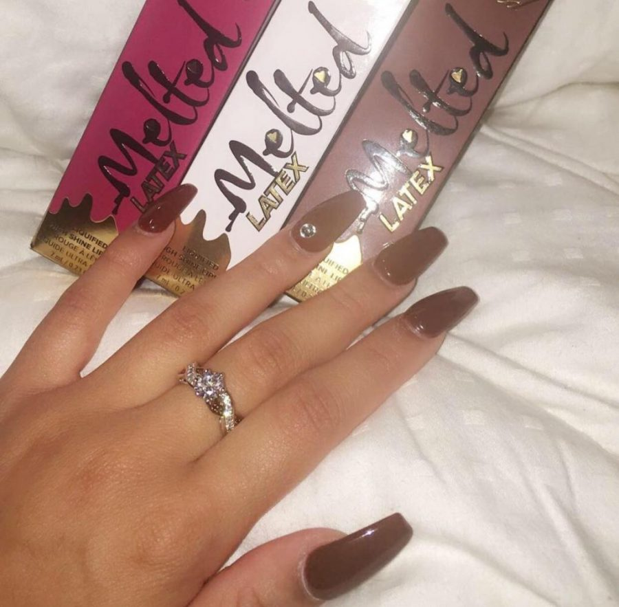 Emma Clark shows off her fingernails after a trip to Llynn's Nail Salon.