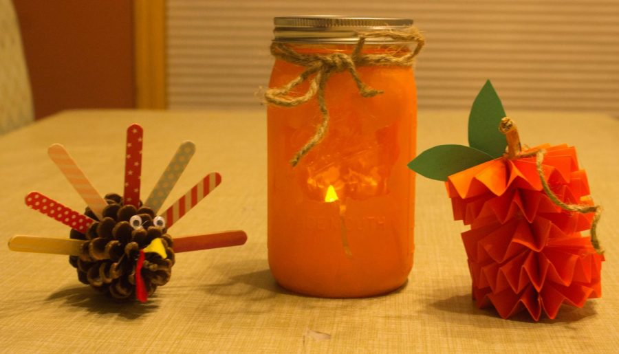 Celebrate Thanksgiving with these DIY crafts: a turkey, a luminary, and a pumpkin.