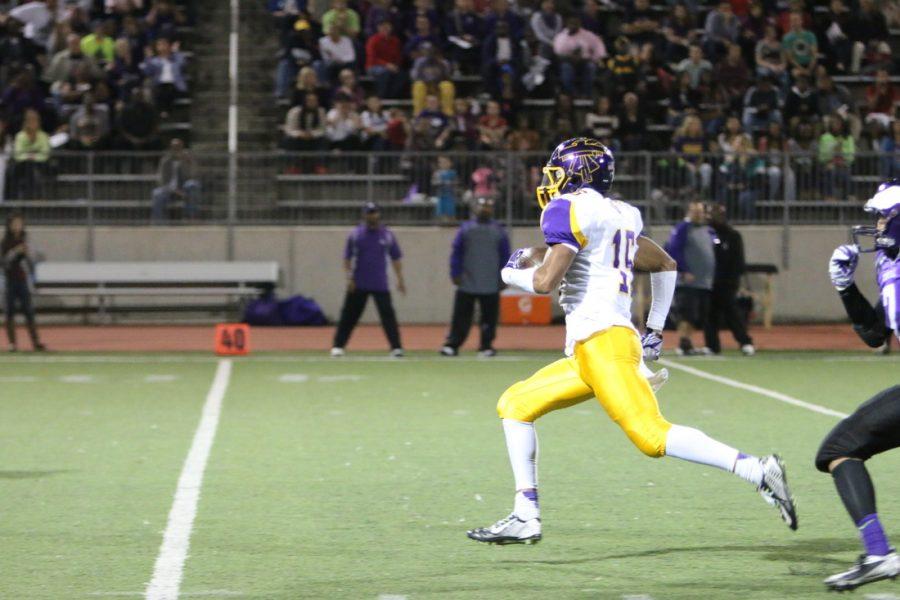Bellevue West alum C.J. Johnson runs down field in a 2014 football game against Omaha Central.