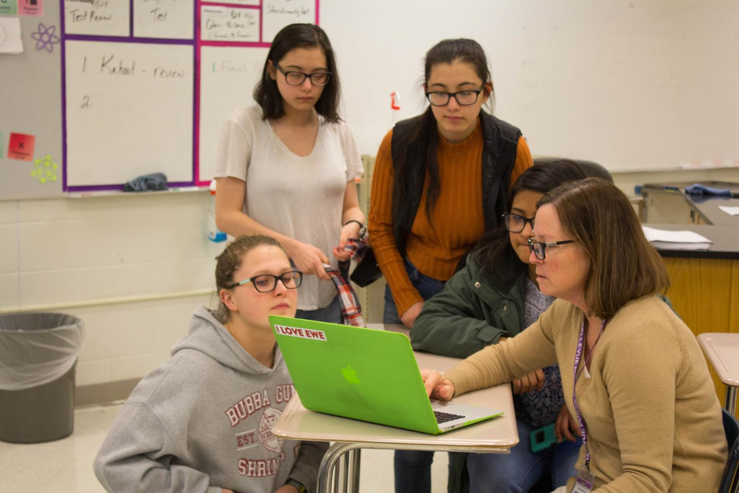 Club members Brittany Horbach, Abby Buddhacharya, Jaque Armas, and Ashley Buddhacarya discuss options for fragrance oils.
