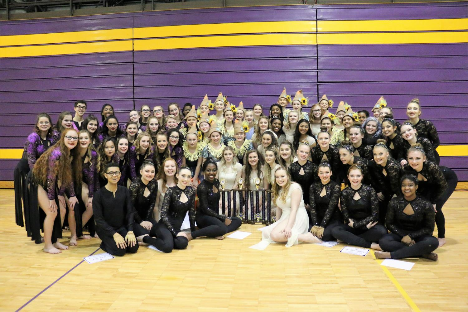 Bellevue West Color Guard groups celebrate their first place finishes.