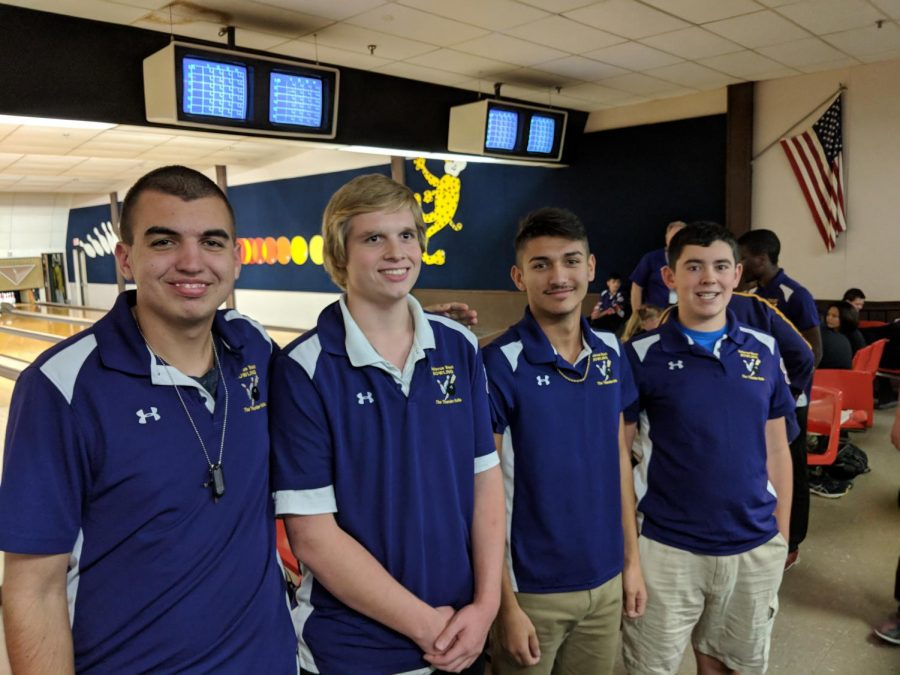 Bellevue West's Varsity Unified Bowling team (Thomas Cooperman, Eric Pierce, Nolan Schenck and Alex Liberty) pose for a picture before their dual.