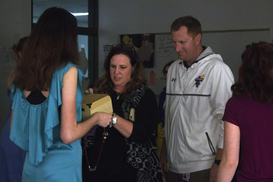 Freshmen Principal Dr. Fran Pokorski and Activities Director Jon Mauro solving a puzzle in the theatre's escape room.