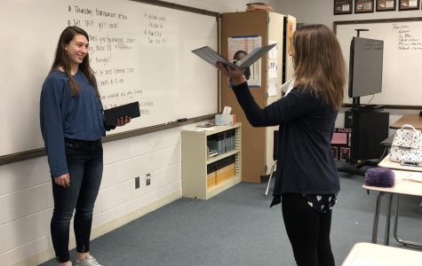 Forensics coach Rebecca Hier works with a student on her presentation skills.