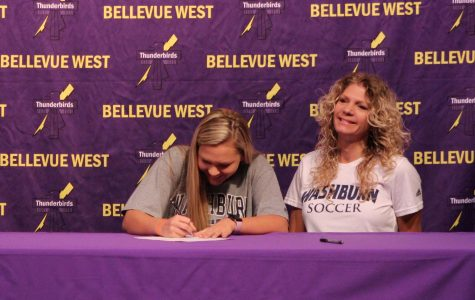 "Senior Chamberlyn Bridge signs letter of intent to play soccer with Washburn University. Her coach Gauthier Scherlizin said, ""her dedication, her work rate, her attitude is going to lead her to success at Washburn."""