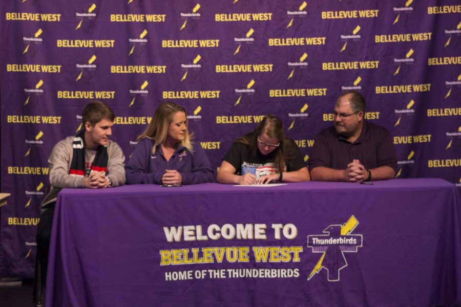 """Senior Madison Machacek signs letter of intent with Bellevue University. Her coach, Laura Kratochvil commented that """"from the moment she stepped on our school to work on softball she had a little something special."""""""
