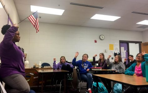 Sign language interpreter Janelle Hunt teaches at Sign Language Club.