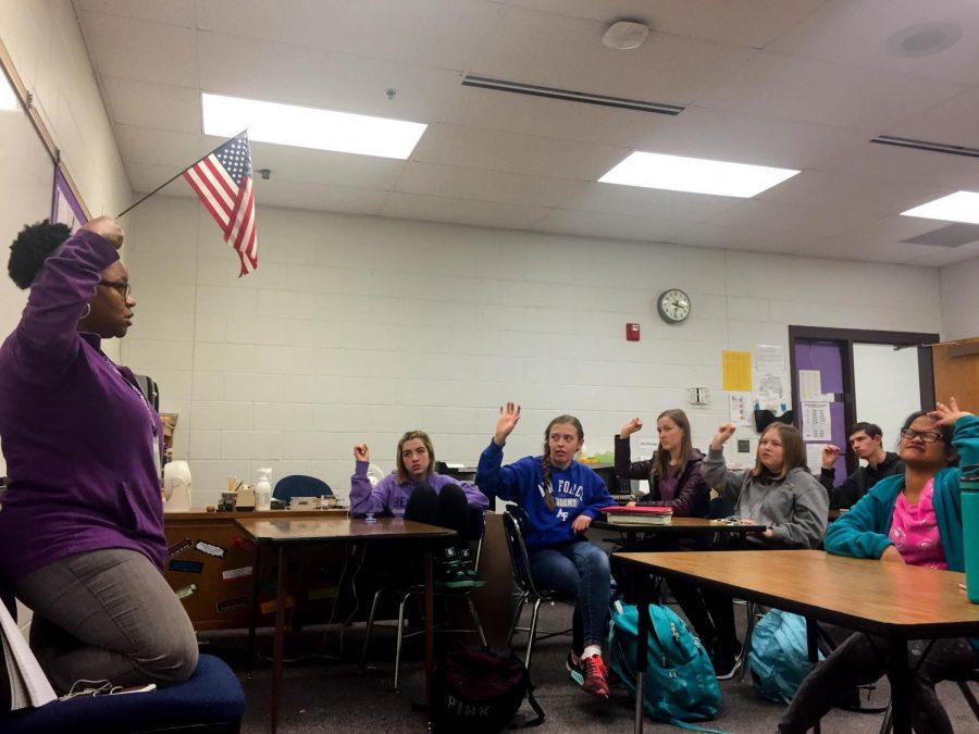 Sign language interpreter Janelle Hunt teaches at Sign Language Club.