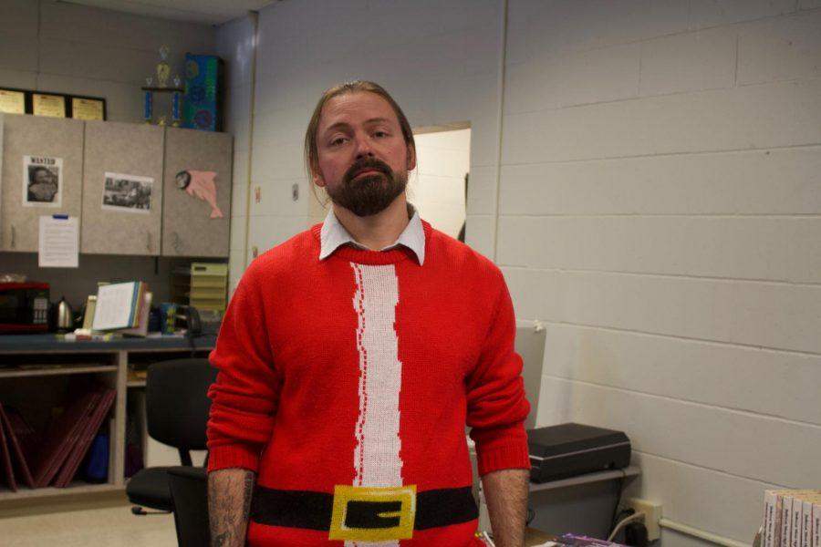 Finals Week. Aaron Stueve wears a Santa sweater.