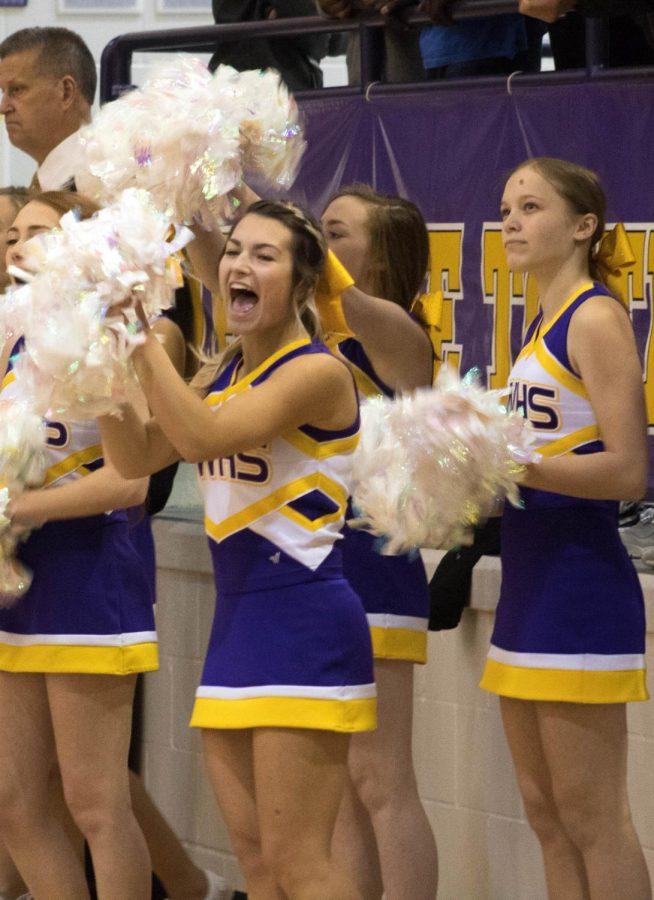 Shout. Senior KK Will cheers on the basketball team.