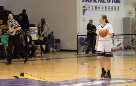 Dribbling. Senior Emma Mullendore looks for teammates to pass to as she dribbles down the court.