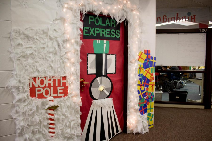"""Mr. Heuertz's advisory won the Christmas door decorating contest. """"One thing about trains: It doesn't matter where they're going. What matters is deciding to go on."""""""