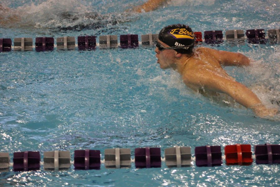 Butterfly-ing out. Freshman Josh Bugay comes out of the water while swimming butterfly.