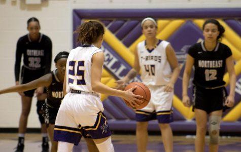 Focus. Freshman Taryn Wharton tries to find a way to pass the ball to senior Bri Hoffman.