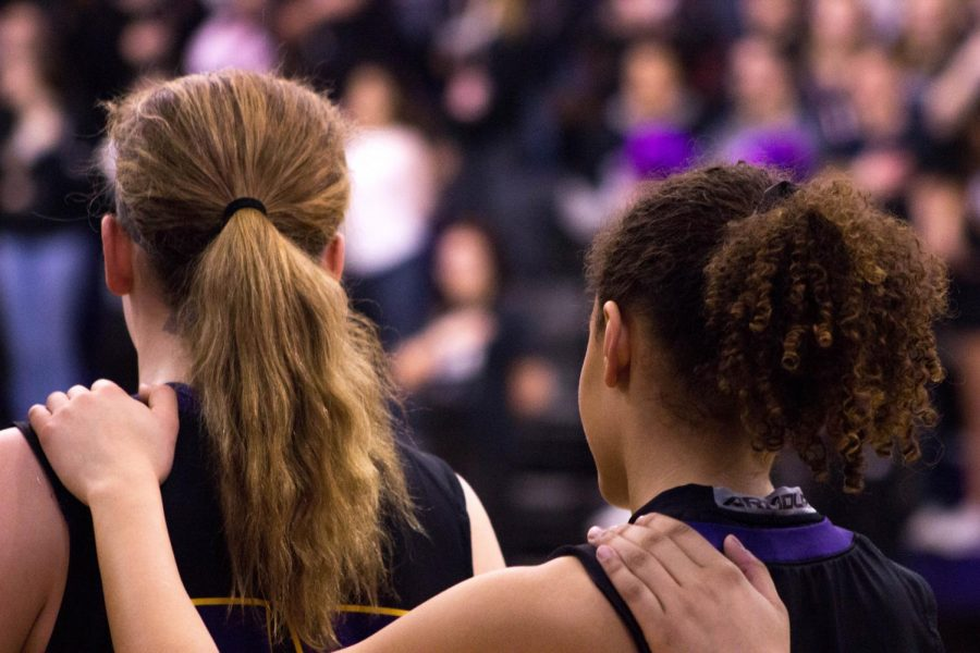 Please+rise.+Two+Bellevue+West+girls+basketball+players+stand+for+the+National+Anthem.