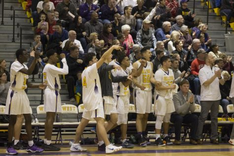 Bellevue West bench celebrates during the Feb. 8 game against No. 5 Creighton Prep.