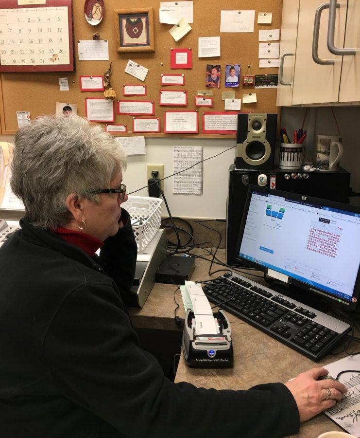 Fine arts paraprofessional Ellen Kershaw looks at the e-tickets seat selector.