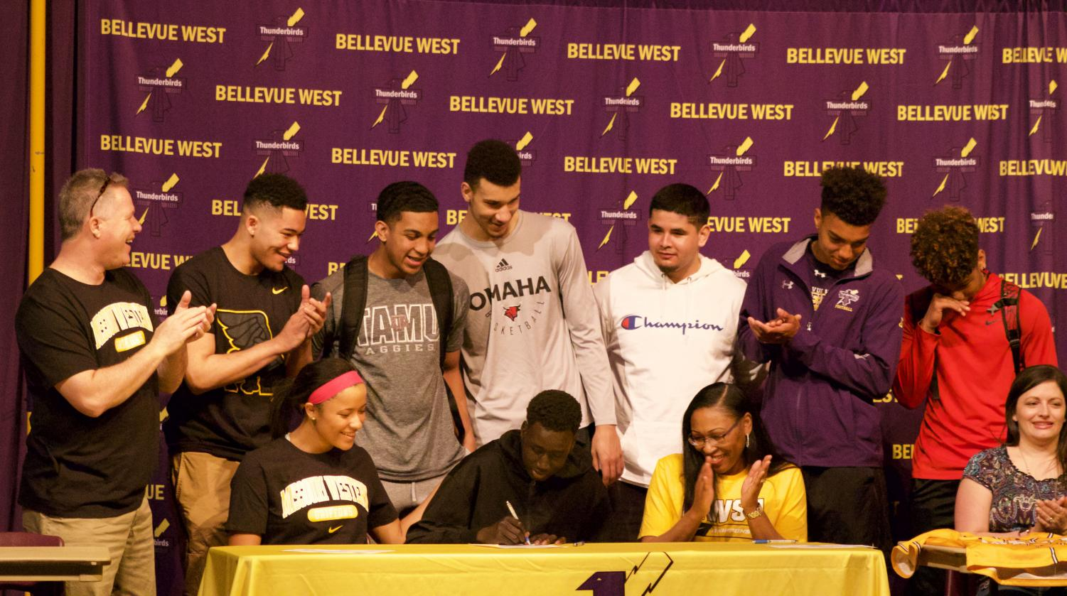 "Senior Deng Jal signs a letter of intent with Bellevue University for basketball. ""He's going to do a tremendous job. I'm excited to keep him around here. I couldn't be happier for him,"" Coach Doug Woodard said."