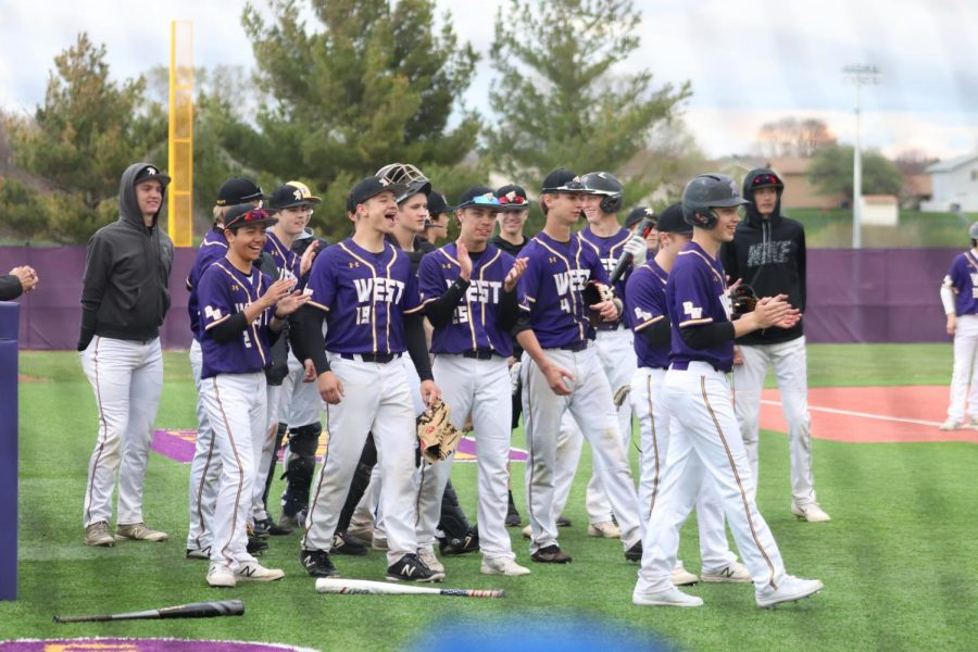 The Bellevue West Thunderbirds get ready to play baseball against the Omaha North Vikings.