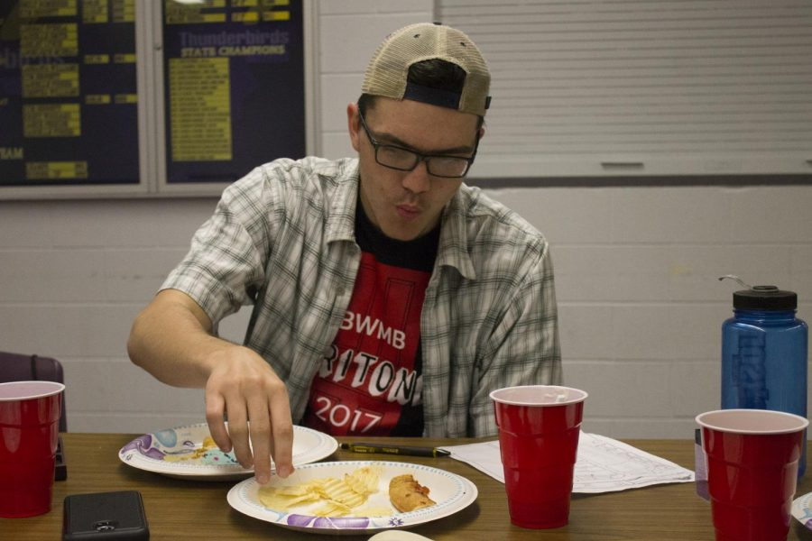 Food for Thought. Senior Jorden Prettyman eats his dinner of pizza and chips while deciding his next move for D&D.