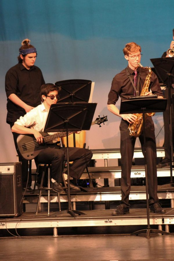 Play.+Senior+jazz+band+members%2C+Jacob+Denton+and+Trevor+Thomas+play+their+instruments.