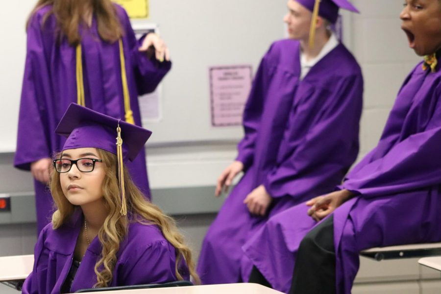 Waiting.+Graduating+seniors+wait+in+classrooms+for+the+ceremony+to+begin.