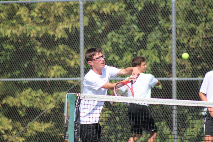 Swing. Junior Trey Conant sets his eyes on the ball and gets ready to hit.