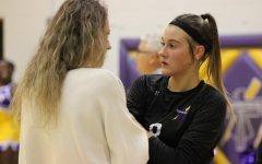 Let's Talk. Coach, Christina Krajieck talks one-on-one to setter, sophomore Jayna Hope before hopping back into the game.