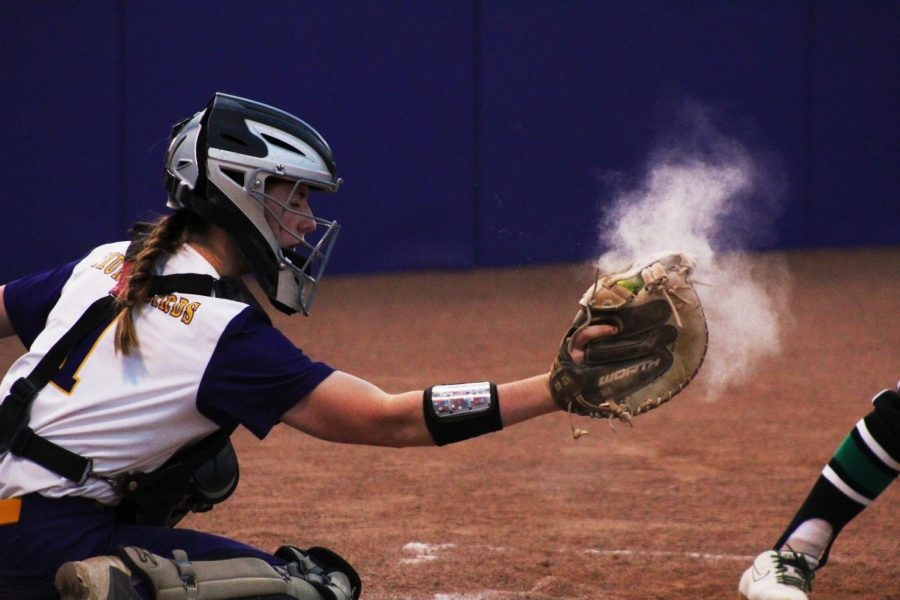 What a catch! Paige Stuck catches a softball covered in dust.