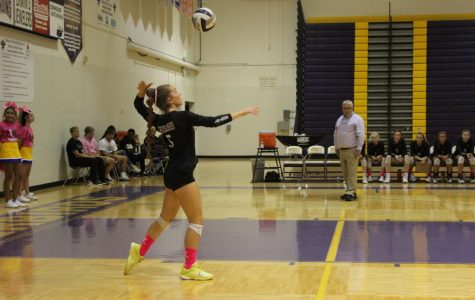 Serve. Sophomore Presley Liberty serves to the other team.