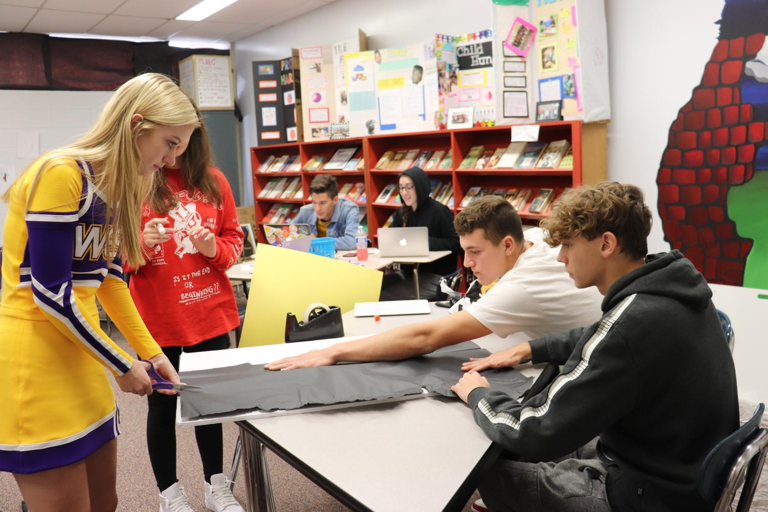 Juniors Karlee Reyome, Julia White, Michael Garza, and Christian Wohlford design a visual aid for the CBL project,