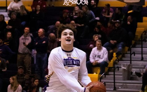 Happy to Hoop. Senior Nate Glantz jumps to make a hoop before the game